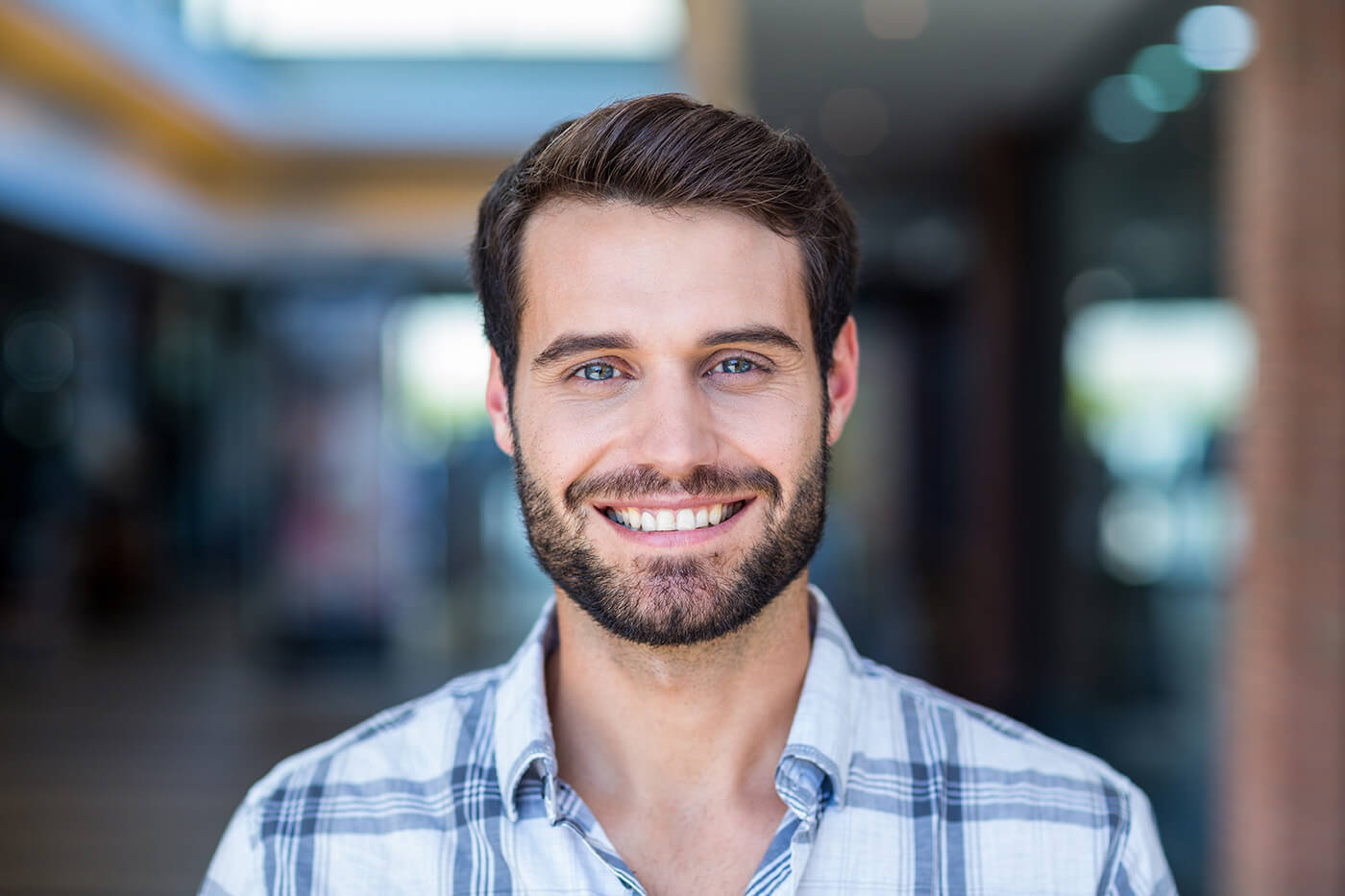 man smiling with teeth